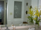 Upgraded Hall bathroom, custom etched window, tiled floor & vanity top
